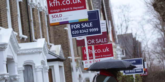 For Sale signs displayed outside houses in Finsbury Park, North London.