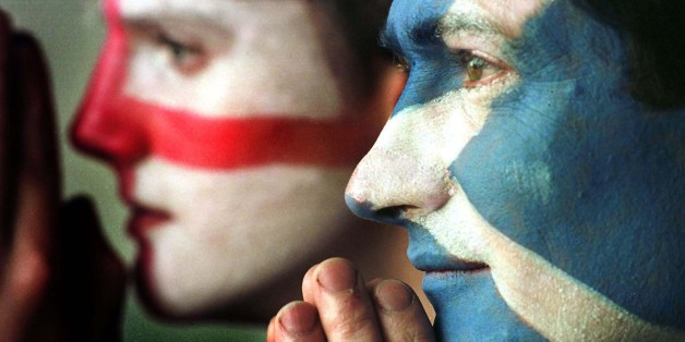 Edinburgh football fans Mark Roberts (right) and David Johns hope for the best for their teams, in the Euro 2000 Championship playoff football match between England and Scotland at Hampden Park stadium, Glasgow, on 13/11/99.