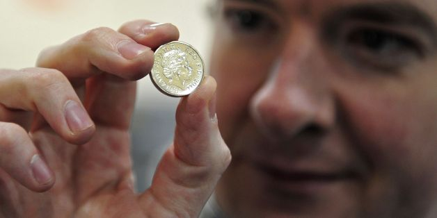CARDIFF, WALES - MARCH 5: Chancellor of the Exchequer George Osborne, poses with a newly minted one pound coin during a visit to the Royal Mint on March 5, 2011 in Cardiff, United Kingdom. The Conservative Party is in Wales for it's annual spring forum. (Photo by Toby Melville - WPA Pool/GEtty Images)