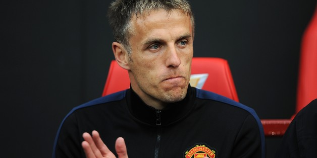 Manchester United coach Phil Neville before the match