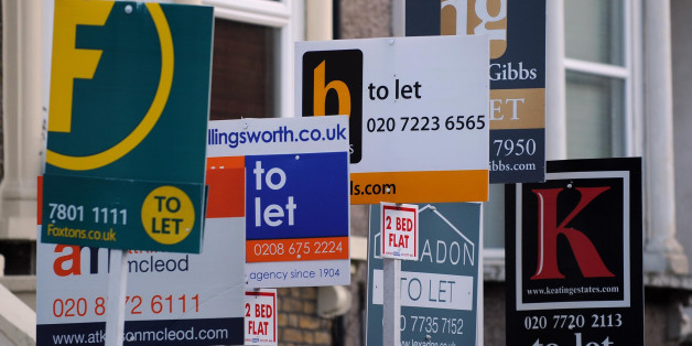 Estate agents boards are seen in Lambeth, London.