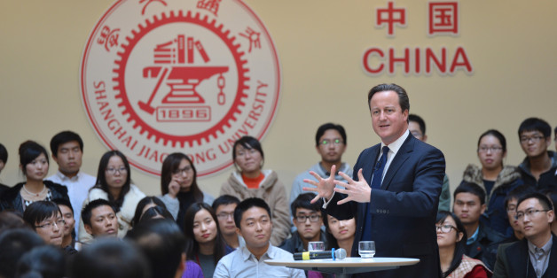 This picture taken on December 3, 2013 shows British Prime Minister David Cameron (R) delivering a speech at Shanghai Jiao Tong University in Shanghai.  Britain should recognise it is not a big power but 'just an old European country apt for travel and study', Chinese state-run media snapped on December 3 as Cameron visited.   CHINA OUT     AFP PHOTO        (Photo credit should read STR/AFP/Getty Images)