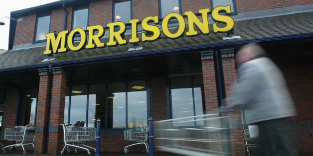 ROCHDALE - JANUARY 9:  A shopper pushes his cart outside a Morrisons supermarket January 9, 2003 in Rochdale, Lancashire. The mid-size British supermarket chain, Morrisons, announced its bid to overtake rival Safeway in a 2.9 billion pound deal that would combine the firm with 589 stores and a 16 percent market share.  (Photo by Laurence Griffiths/Getty Images)