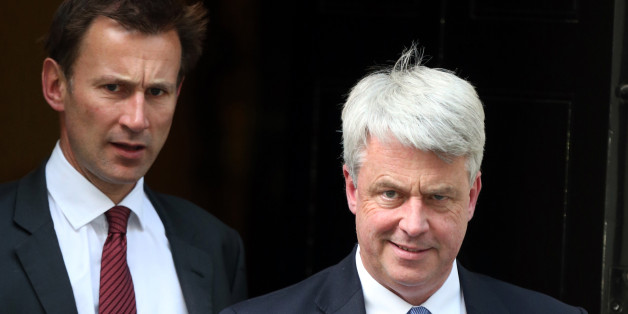 NOTE ALTERNATE CROP.Health secretary Jeremy Hunt (left) and Leader of the Commons Andrew Lansley leave a cabinet meeting at Downing Street in London, after Prime Minister David Cameron hailed his new-look top team, insisting he had put the right people in place to kick start the flagging economy.