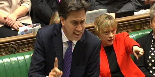 Labour party leader Ed Miliband speaks as Angela Eagle points during Prime Minister's Questions in the House of Commons, London.