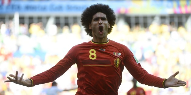 Belgium's midfielder Marouane Fellaini celebrates after scoring during a Group H football match between Belgium and Algeria at the Mineirao Stadium in Belo Horizonte during the 2014 FIFA World Cup on June 17, 2014.      AFP PHOTO / MARTIN BUREAU        (Photo credit should read MARTIN BUREAU/AFP/Getty Images)