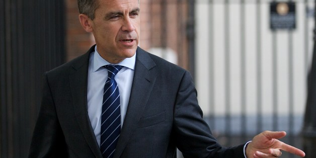 Mark Carney, Governor of the Bank of England leaves number 10 Downing Street after a Global Economy Roundtable meeting in London on June 17, 2014. AFP PHOTO / ANDREW COWIE        (Photo credit should read ANDREW COWIE/AFP/Getty Images)