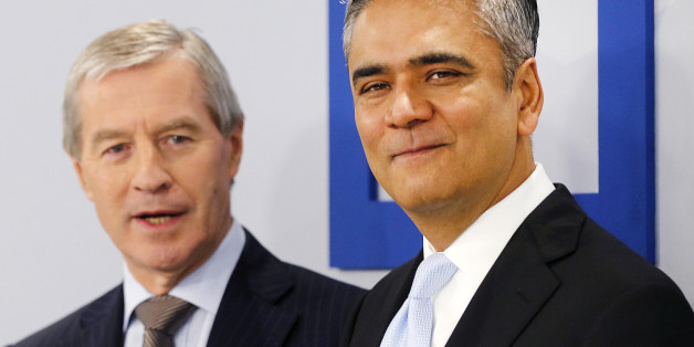 CEOs of Deutsche Bank Anshu Jain, right, and Juergen Fitschen stand together prior to the annual press conference in Frankfurt, Germany, Wednesday, Jan. 29, 2014. Germany's biggest bank had a surprise loss of 965 million euros (US dollar 1.32 billion) in the fourth quarter, as earnings were burdened by 528 million in costs for court settlements and investigations into alleged past misconduct in the fourth quarter. (AP Photo/Michael Probst)