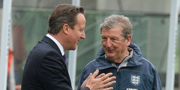Prime Minister David Cameron chats with England manager Roy Hodgson during a training session at England's football training headquarters St Georges Park, in Burton-Upon-Trent.
