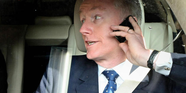 (FILES) Sir Fred Goodwin, Chief-Executive Officer of the Royal Bank of Scotland, speaks on his mobile phone as he leaves the Edinburgh International Conference Centre, on April 23, 2008. Royal Bank of Scotland on Monday October 13, 2008, unveiled plans to raise 20 billion pounds with government help and said its chief executive Fred Goodwin would step down as RBS looks to recover from the credit crunch. AFP PHOTO/ED JONES/FILES (Photo credit should read ED Jones/AFP/Getty Images)