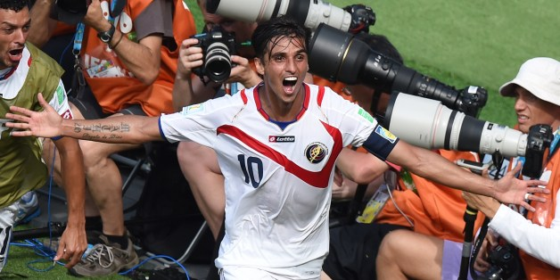 Costa Rica's forward Bryan Ruiz celebrates after scoring his team's first goal during a Group D match between Italy and Costa Rica at the Pernambuco Arena in Recife during the 2014 FIFA World Cup on June 20, 2014.  AFP PHOTO / JAVIER SORIANO        (Photo credit should read JAVIER SORIANO/AFP/Getty Images)