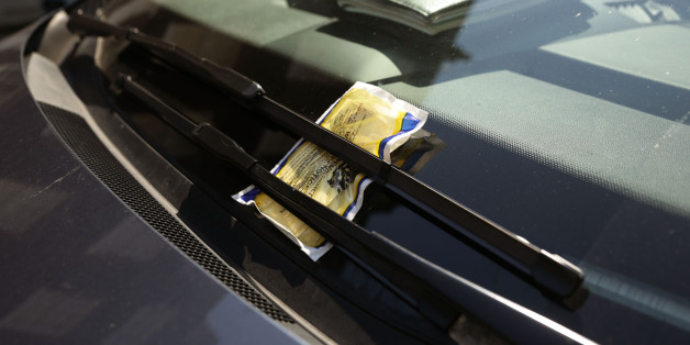 A parking ticket on a car windscreen in Westminster, central London.