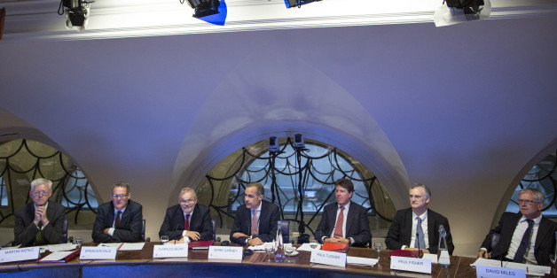 L-R) Martin Weale, a monetary policy committee member at the Bank of England, Spencer Dale, chief economist at the Bank of England, Charles Bean, deputy governor of the Bank of England, Mark Carney, governor of the Bank of England, Paul Tucker, outgoing deputy governor of the Bank of England, Paul Fisher, markets director at the Bank of England, David Miles, a monetary policy committee member at the Bank of England, attend a monetary policy committee (MPC) briefing inside the central bank's head