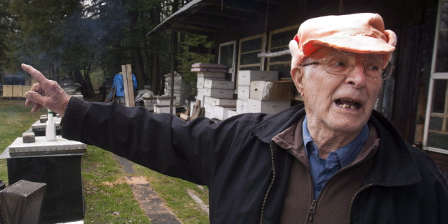 Vladimir Katriuk points at his honeybee farm in Ormstown, Que., Wednesday, April 25, 2012. Katriuk, alleged to be one of the world's most-wanted Nazi war criminals, is living a quiet life keeping bees and selling honey in rural Quebec. THE CANADIAN PRESS/Ryan Remiorz