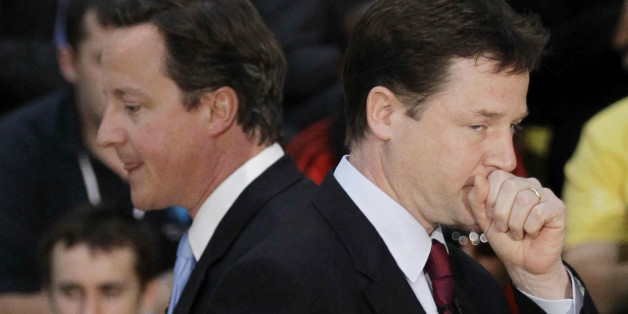 File photo dated 12/5/2011 of Prime Minister David Cameron walks past Deputy Prime Minister Nick Clegg. The pair must draw up rules to stop public splits on government policy after a spate of clashes, peers have warned.