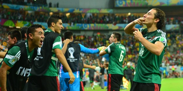 Mexico's defender Andres Guardado (R) celebrates with Mexico's midfielder Jose Juan Vazquez after scoring the 0-2 during a Group A football match between Croatia and Mexico at the Pernambuco Arena in Recife during the 2014 FIFA World Cup on June 23, 2014. AFP PHOTO / YURI CORTEZ        (Photo credit should read YURI CORTEZ/AFP/Getty Images)
