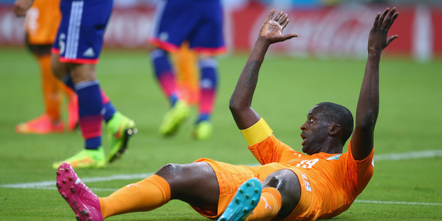 RECIFE, BRAZIL - JUNE 14: Yaya Toure of the Ivory Coast reacts during the 2014 FIFA World Cup Brazil Group C match  between the Ivory Coast and Japan at Arena Pernambuco on June 14, 2014 in Recife, Brazil.  (Photo by Julian Finney/Getty Images)