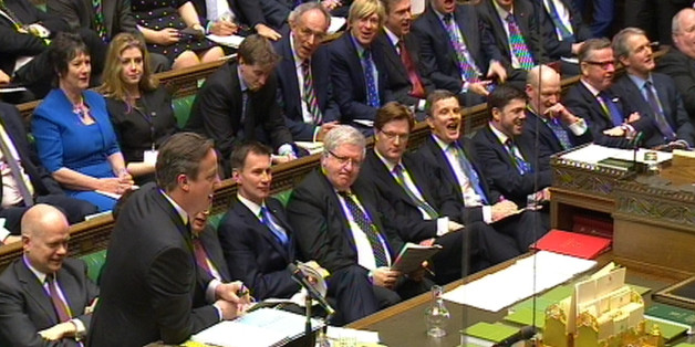 A view of the Government front bench as Prime Minister David Cameron speaks during Prime Minister's Questions in the House of Commons, London.