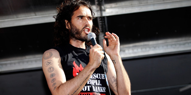 LONDON, ENGLAND - JUNE 21:  Comedian Russell Brand speaks to a crowd of thousand of demonstrators that  gathered in Parliament Square, on June 21, 2014 in London, England. The crowd marched from Oxford Circus to Parliament Square to voice their opposition to government austerity cuts. (Photo by Mary Turner/Getty Images)