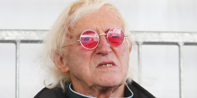 File photo dated 11/10/10 of Jimmy Savile as findings of a series of major investigations by NHS hospitals into allegations of abuse by the disgraced presenter have been published.