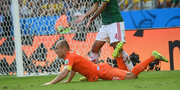 Mexico's defender and captain Rafael Marquez (TOP) reacts after the awarding of a penalty after a tackle on Netherlands' forward Arjen Robben (R) during a Round of 16 football match between Netherlands and Mexico at Castelao Stadium in Fortaleza during the 2014 FIFA World Cup on June 29, 2014. AFP PHOTO / EMMANUEL DUNAND        (Photo credit should read EMMANUEL DUNAND/AFP/Getty Images)