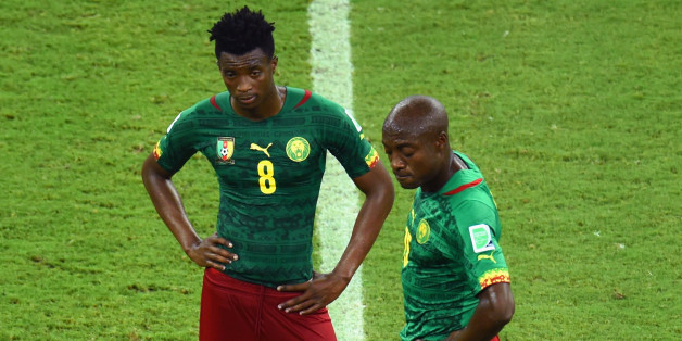 MANAUS, BRAZIL - JUNE 18:  Benjamin Moukandjo and Pierre Webo of Cameroon wait to kick off after a goal during the 2014 FIFA World Cup Brazil Group A match between Cameroon and Croatia at Arena Amazonia on June 18, 2014 in Manaus, Brazil.  (Photo by Stu Forster/Getty Images)