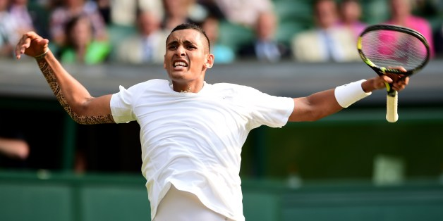 Australia's Nick Kyrgios celebrates winning a game against Spain's Rafael Nadal during their men's singles fourth round match on day eight of the 2014 Wimbledon Championships at The All England Tennis Club in Wimbledon, southwest London, on July 1, 2014. AFP PHOTO / CARL COURT  - RESTRICTED TO EDITORIAL USE        (Photo credit should read CARL COURT/AFP/Getty Images)