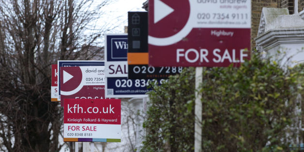 File photo dated 27/01/14 of for sale signs displayed outside houses in Finsbury Park, North London. House prices surged by 8.8\% year-on-year in January as they continued to increase at their fastest pace since 2010, Nationwide has reported.