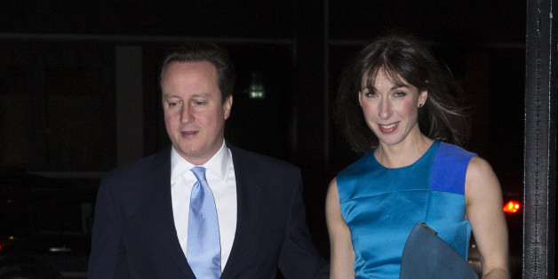 LONDON, ENGLAND - FEBRUARY 05: British Prime Minister David Cameron and his wife Samantha arrive at the Old Billingsgate Market to attend the the annual Conservative Party Black and White Fundraising Ball on February 5, 2014 in London, England. (Photo by Oli Scarff/Getty Images)