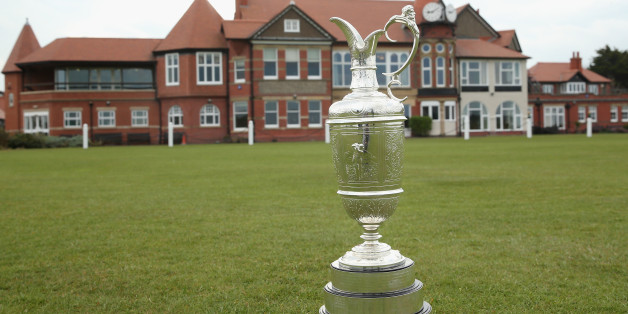 HOYLAKE, ENGLAND - APRIL 23:  The Open Championship trophy (also known as the claret jug) is pictured in front of the clubhouse during The Open Championship Media Day at Royal Liverpool Golf Club on April 23, 2014 in Hoylake, England.  (Photo by Andrew Redington/Getty Images)