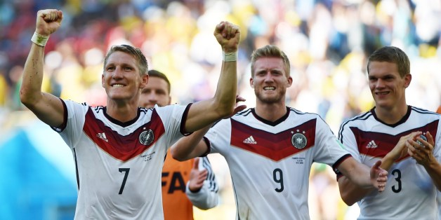 (L/R): Germany's midfielder Bastian Schweinsteiger, Germany's forward Andre Schuerrle and Germany's defender Matthias Ginter react after victory in the quarter-final football match between France and Germany at The Maracana Stadium in Rio de Janeiro on July 4, 2014,during the 2014 FIFA World Cup.  AFP PHOTO / PATRIK STOLLARZ        (Photo credit should read PATRIK STOLLARZ/AFP/Getty Images)