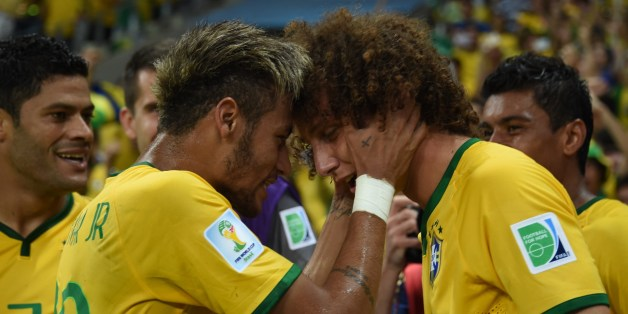 Brazil's forward Neymar (L) celebrates with Brazil's defender David Luiz during the quarter-final football match between Brazil and Colombia at the Castelao Stadium in Fortaleza during the 2014 FIFA World Cup on July 4, 2014. AFP PHOTO / VANDERLEI ALMEIDA        (Photo credit should read VANDERLEI ALMEIDA/AFP/Getty Images)