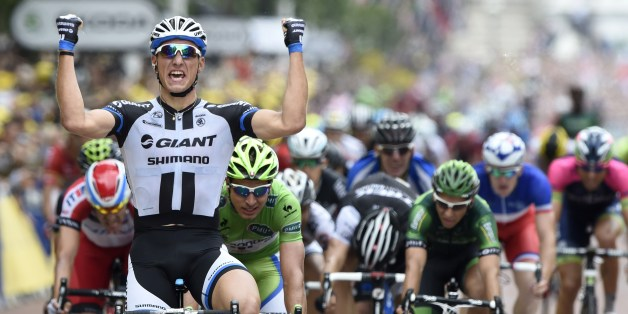 Germany's Marcel Kittel celebrates as he crosses the finish line at the end of the 155 km third stage of the 101st edition of the Tour de France cycling race on July 7, 2014 between Cambridge and London, southwestern England.  AFP PHOTO / ERIC FEFERBERG        (Photo credit should read ERIC FEFERBERG/AFP/Getty Images)