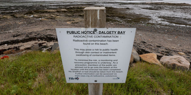 A sign next to Dalgety Bay beach in Fife as former prime minister Gordon Brown has called on the Ministry of Defence to fund the clean-up of the beach polluted by radiation after a report by an environmental agency named the Government department as responsible.