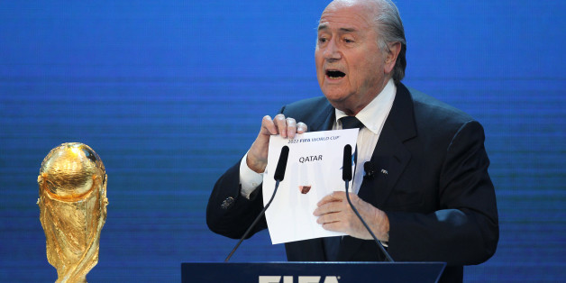 FIFA president Joseph Blatter opens the envelope to reveal that Qatar will host the 2022 World Cup at the FIFA headquarters in Zurich on December 2, 2010. Qatar became the first Arab, Middle Eastern or Muslim country to be awarded the right to stage football's World Cup. AFP PHOTO/KARIM JAAFAR (Photo credit should read KARIM JAAFAR/AFP/Getty Images)