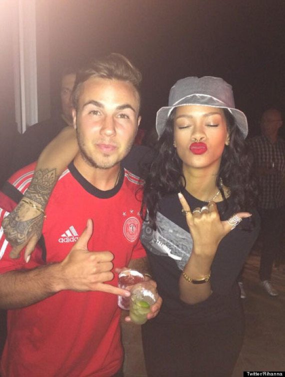 Rihanna Celebrates Germany's World Cup Win Over Argentina By Posing For Pics With Mario Götze And Flashing Her Bra (PICS)
