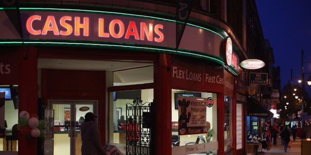 LONDON, ENGLAND - NOVEMBER 01:  A general view of a 'Speedy Cash' cash loans shop on Brixton High Street on November 1, 2012 in London, England. The recession has changed the face of the UK's high streets, which have seen a boom in bookmakers, discount stores, charity shops, cheque cashing (payday loans) and pawnbrokers as cash-strapped Brits struggled with their finances.  (Photo by Dan Kitwood/Getty Images)