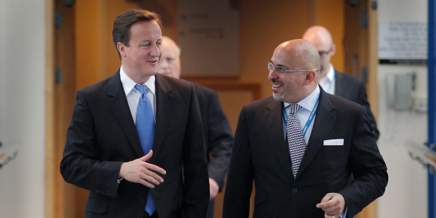 BIRMINGHAM, ENGLAND - OCTOBER 05:  Prime Minister David Cameron (L) walks with Conservative MP Nadhim Zahawi at the Conservative Party Conference during a television interview on October 5, 2010 in Birmingham, England. On the third day of the conference speakers are set to debate public services, crime and justice and poverty.  (Photo by Peter Macdiarmid/Getty Images)