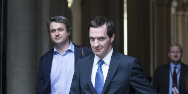 LONDON, ENGLAND - JULY 15:  George Osborne (C), the Chancellor of the Exchequer, arrives in Downing Street on July 15, 2014 in London, England. British Prime Minister David Cameron is conducting a reshuffle of his Cabinet team with a greater number of women expected to be appointed to senior positions.  (Photo by Oli Scarff/Getty Images)
