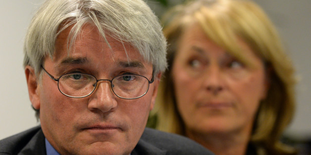 Andrew Mitchell and his wife Dr Sharon Bennett during a press conference in London, as he gives his reaction to the Crown Prosecution Service decision on the Plebgate row.