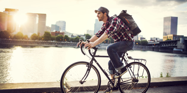 Image result for person cycling in city