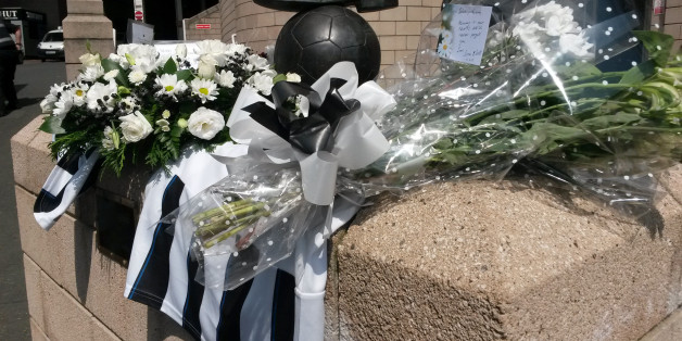 Flowers and football shirts around the Sir Bobby Robson statue outside Newcastle football ground after two fans died on board flight MH17 which was shot down over the Ukraine.