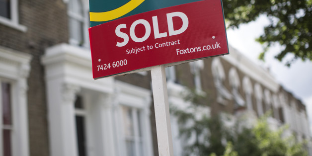 LONDON, ENGLAND - JUNE 03:  An estate agent sold sign is displayed outside a property on June 3, 2014 in London, England. Figures from the Nationwide, the UK's largest building society, have shown that in the year to May, the annual rise in house prices was 11.1% which represents the greatest rate of increase in seven years.  (Photo by Oli Scarff/Getty Images)