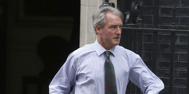 Secretary of State for Environment, Food and Rural Affairs, Owen Paterson leaves 10 Downing Sreet in central London after a cabinet meeting.