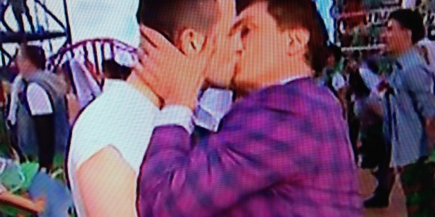 John Barrowman Delivers Rebuke To Anti-LGBT Countries With Commonwealth Games Kiss