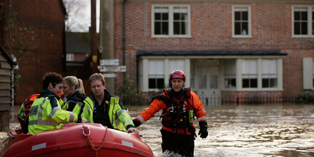 YALDING, UNITED KINGDOM - DECEMBER 25:  Emergency services operate along streets submerged beneath floodwaters on December 25, 2013 in Yalding, England. Christmas plans have been badly affected for thousands of people after storms across the UK have resulted in flooding, power cuts and significant problems with transport infrastructure.  (Photo by Matthew Lloyd/Getty Images)