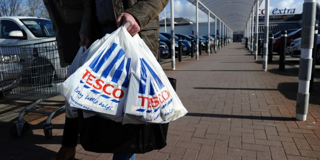 (FILES) In this file picture taken on March 5, 2012 people carry shopping bags through the carpark of a Tesco Extra supermarket in Birkenhead, north-west England.  Britain's biggest retailer, supermarket Tesco, looked on course to withdraw from its struggling US business Fresh & Easy as chief executive Philip Clarke on December 5, 2012 said its presence would likely end.  AFP PHOTO / PAUL ELLIS        (Photo credit should read PAUL ELLIS/AFP/Getty Images)