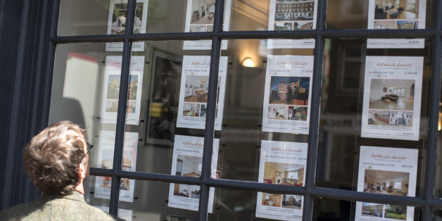 LONDON, ENGLAND - JUNE 03:  A man looks at property details displayed in the window of an estate agent in Camden on June 3, 2014 in London, England. Figures from the Nationwide, the UK's largest building society, have shown that in the year to May, the annual rise in house prices was 11.1% which represents the greatest rate of increase in seven years.  (Photo by Oli Scarff/Getty Images)