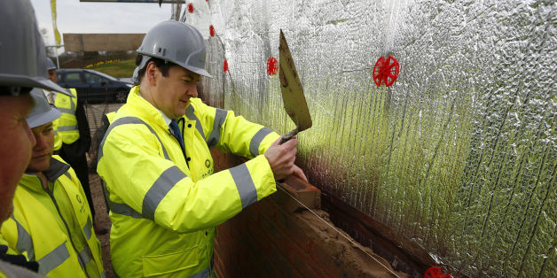 Chancellor of the Exchequer George Osborne lays a brick during a visit to a Barratt Homes building site in Nuneaton, the day after he said in his annual budget that the government would extend the equity loan portion of the Help to Buy scheme for four years longer than planned to 2020, a move he said would deliver 120,000 new homes.