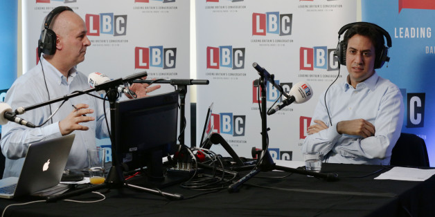 Leader of the Labour Party Ed Miliband taking part in live phone-in on the LBC national commercial news talk station with presenter Iain Dale (left)